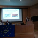 Mrs. Chrysoula Papathanasiou presents the assessment of the flood risk before and after a fire during the networking part of the meeting.